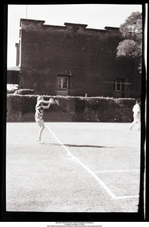 Playing tennis in Tamsui at the British Consulate